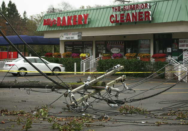 A utility pole lies collapsed in the parking lot of Black Rock Turnpike businesses in the aftermath of Hurricane Sandy in Fairfield on Thursday, November 1, 2012. Photo: Brian A. Pounds / Connecticut Post