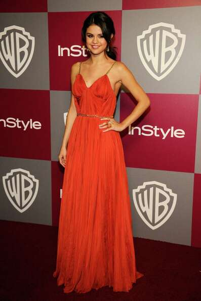Actress Selena Gomez arrives at the 2011 InStyle And Warner Bros. 68th Annual Golden Globe Awards po