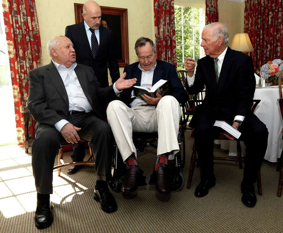 Former President of the Soviet Union Mikhail Gorbachev, left, visits with former President George H.W. Bush, center, and former Secretary of State James Baker, right, before having lunch Thursday, Nov. 1, 2012, in Houston. Gorbachev is in Houston to speak at the Brilliant Lecture Series. Standing behind is Gorbachev's adviser Paval Palazhchenko. (AP Photo/David J. Phillip) Photo: David J. Phillip, Associated Press / AP