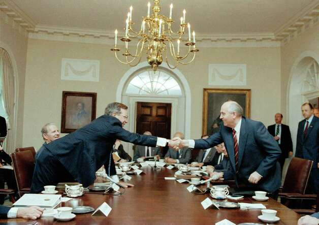 President George Bush and Soviet President Mikhail Gorbachev shake hands across the Cabinet Room table prior to the beginning of their talks at the White House in Washington, May 31, 1990.  Photo: Marcy Nighswander, ASSOCIATED PRESS / AP