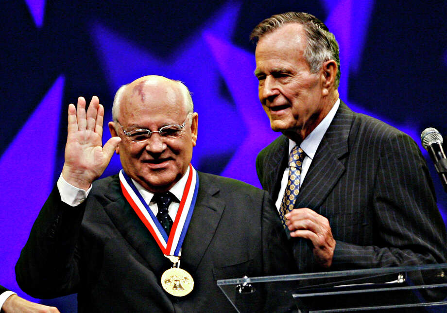Mikhail Gorbachev, left, the former Soviet leader and Nobel Peace Prize winner, acknowledges the audience after being presented with the 2008 Liberty Medal by former U.S. President George H.W. Bush, Chairman of the National Constitution Center, during a ceremony at the center, Thursday, Sept. 18, 2008, in Philadelphia. Photo: Tom Mihalek, AP / AP