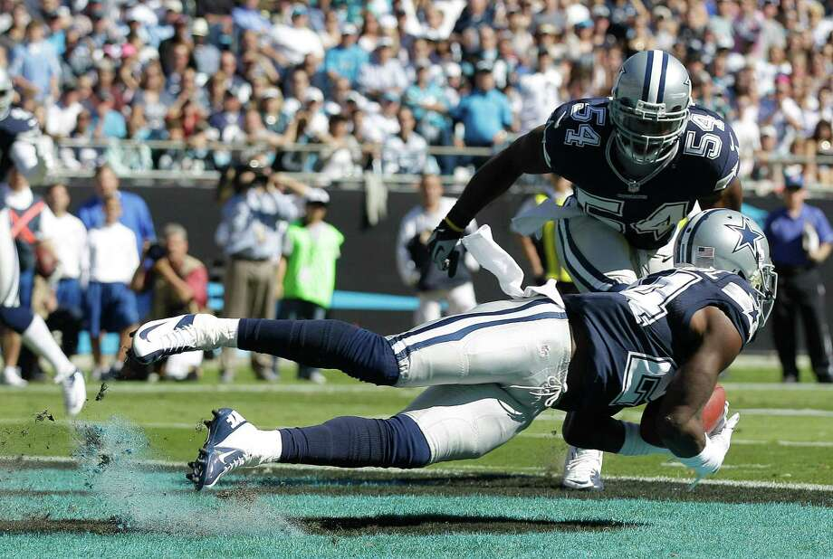 Dallas Cowboys cornerback Morris Claiborne (24) picks off a Carolina Panthers quarterback Cam Newton pass during the first half of an NFL football game, Sunday, Oct. 21, 2012, in Charlotte. Dallas Cowboys inside linebacker Bruce Carter (54) looks on (AP Photo/Chuck Burton) Photo: Chuck Burton, Associated Press / AP