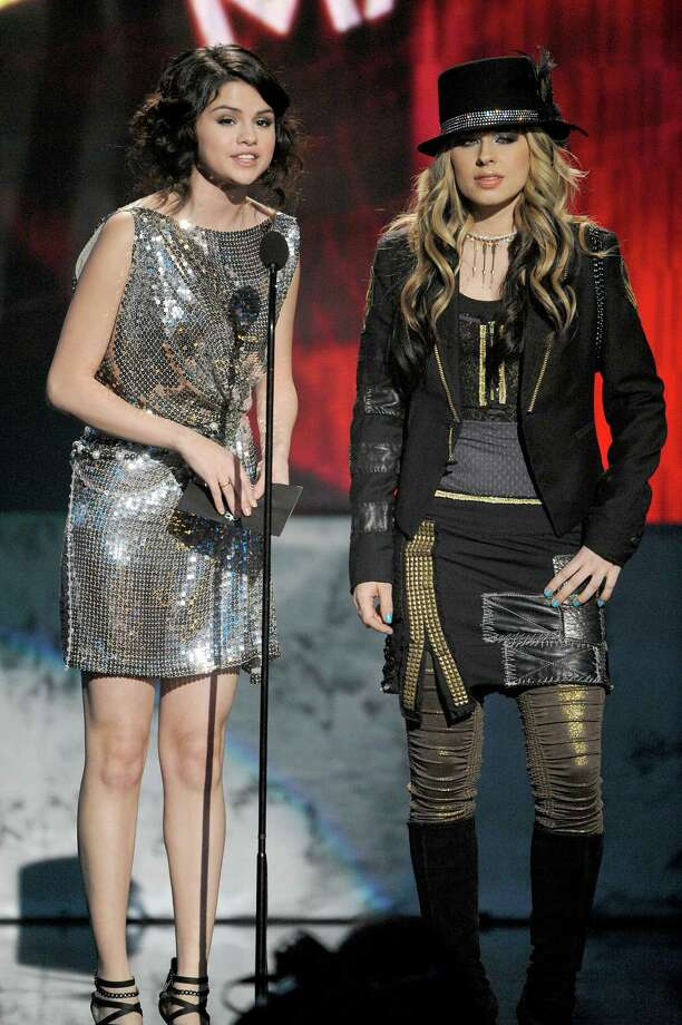 Actress Selena Gomez (L) and singer Orianthi onstage at the 2009 American Music Awards at Nokia Theatre L.A. Live on November 22, 2009 in Los Angeles, California. Photo: Kevork Djansezian, Getty Images / Getty Images North America