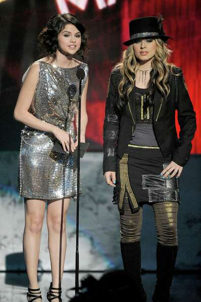 Actress Selena Gomez (L) and singer Orianthi onstage at the 2009 American Music Awards at Nokia Thea