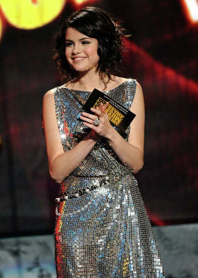 Actress Selena Gomez speaks onstage at the 2009 American Music Awards at Nokia Theatre L.A. Live on November 22, 2009 in Los Angeles, California. Photo: Kevork Djansezian, Getty Images / Getty Images North America