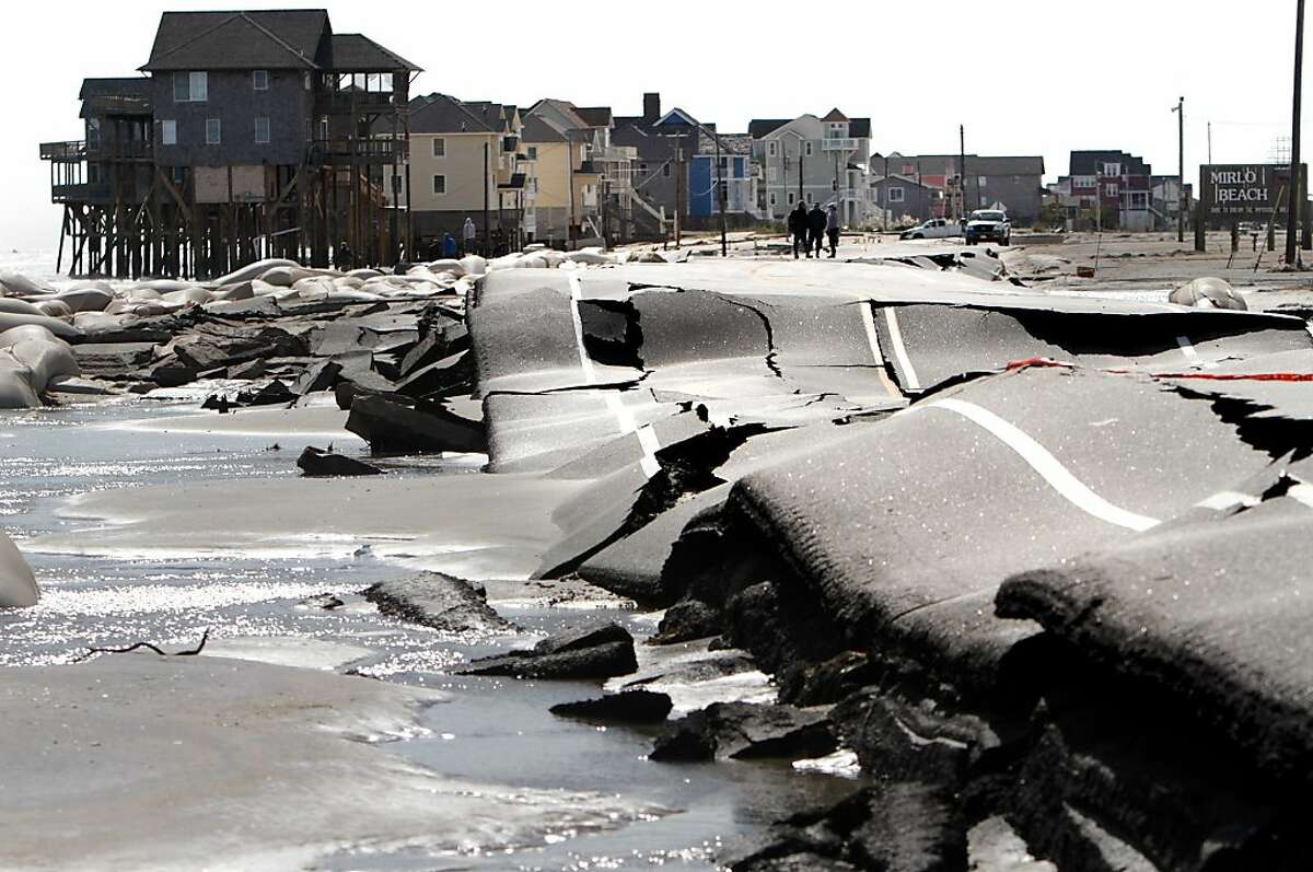 A road leading into Mirlo Beach in Rodanthe, N.C., is closed after sustaining major buckling from pounding surf. Hurricane Sandy highlights the frail state of the nation's infrastructure.