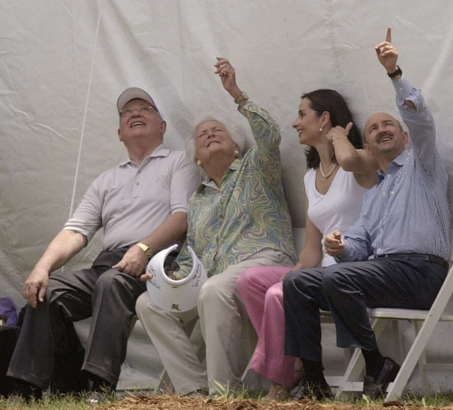 Former Russian President Mikhail Gorbachev, from left right, Barbara Bush, Ana Paula Gerard Salinas, wife of former President of Mexico Carlos Salinas de Gortari, right,  look to the sky as they wait for former President George Bush to make a tandem jump  Sunday, June 13, 2004 at his presidential library in College Station. Photo: DAVID J. PHILLIP, AP / AP
