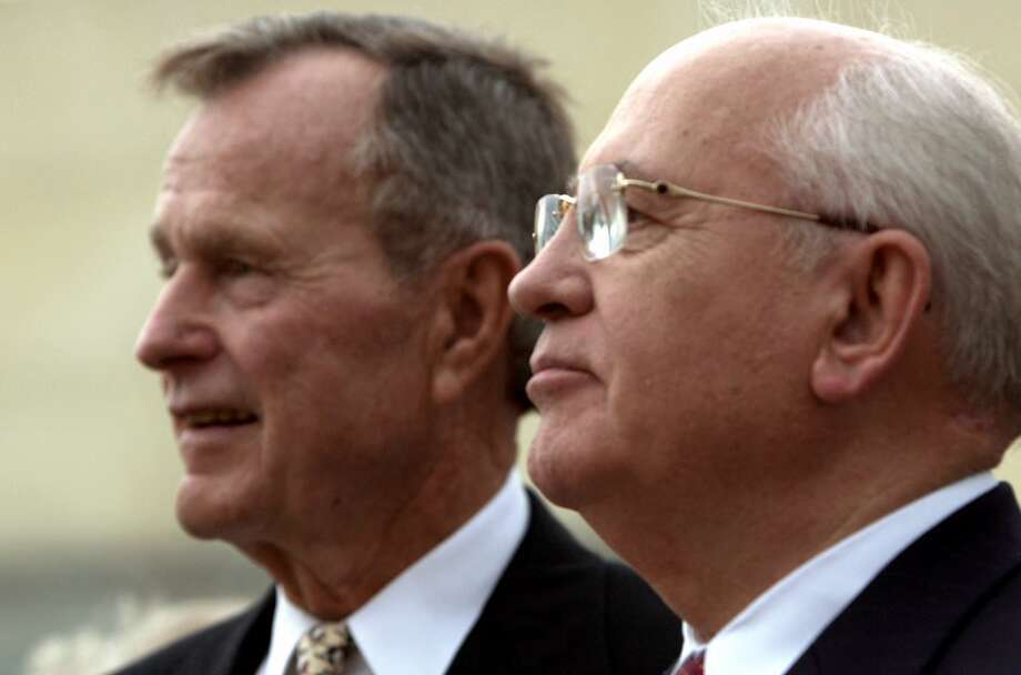 Former Soviet leader Mikhail Gorbachev, right, and former President George Bush watch performers during a reception at the George Bush Presidential Library Thursday, April 12, 2001, in College Station, Texas. Gorbachev is scheduled to receive the inaugural Bush Award for Excellence in Public Service from the former president later this evening. Photo: DAVID J. PHILLIP, AP / AP