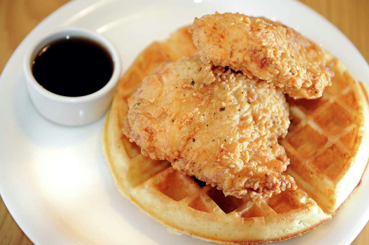 Chicken and waffles with two boneless fried chicken breasts, a waffle and maple syrup on Tuesday, Oct. 30, 2012, at The Flying Chicken in Troy, N.Y. (Cindy Schultz / Times Union)