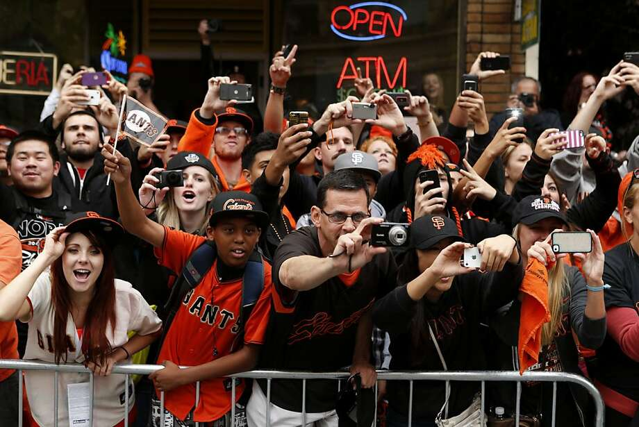 Fans cheered, took pictures and bought up souvenirs at Wednesday's parade for the Giants' World Series title. Photo: Beck Diefenbach, Special To The Chronicle