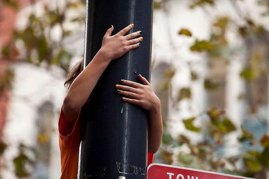 As thick as crowds were people found ways to watch the parade from signs, bus stops, store fronts, trucks, trees and Muni stops for the Giants World Series Championship parade in San Francisco, Calif., Wednesday, October 31, 2012. Photo: Jason Henry, Special To The Chronicle