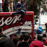As thick as crowds were people found ways to watch the parade from signs, bus stops, store fronts, trucks, trees and Muni stops for the Giants World Series Championship parade in San Francisco, Calif., Wednesday, October 31, 2012.