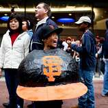 Ryan Eyee, 10, wore this papier-mache Giants hat during the Giants World Series Championship parade in San Francisco, Calif., Wednesday, October 31, 2012.