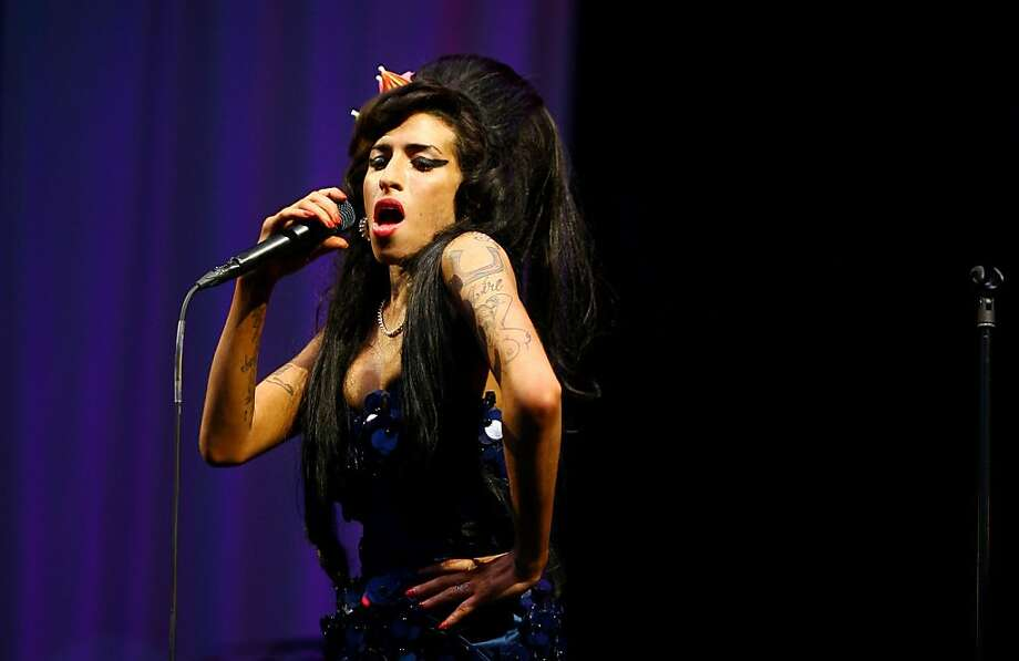(FILES) - Picture taken on June 28, 2008 shows British singer Amy Winehouse performing at the Glastonbury Festival at Worthy Farm, in Glastonbury. The life of late British singer Amy Winehouse is the focus of a new play opening in January at the Danish Royal Theatre in Copenhagen, the theatre said on October 24, 2012. AFP PHOTO/BEN STANSALLBEN STANSALL/AFP/Getty Images Photo: Ben Stansall, AFP/Getty Images