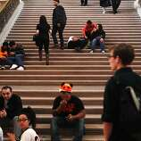Fans and citizens wait in the hopes of seeing Giants players in City Hall after a parade honoring the San Francisco Giants' victory in the World Series on October 31, 2012 in San Francisco, Calif.