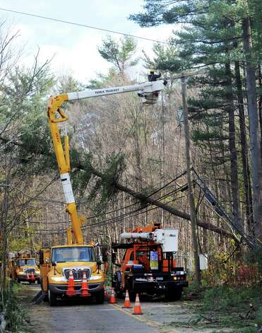Crews from Connecticut Light & Power and a tree crew from North Carolina work on North Stamford Road at High Ridge Road, continuing the effort to restore service to Stamford, Conn. on Thursday, Nov. 1, 2012. Photo: Cathy Zuraw / Stamford Advocate