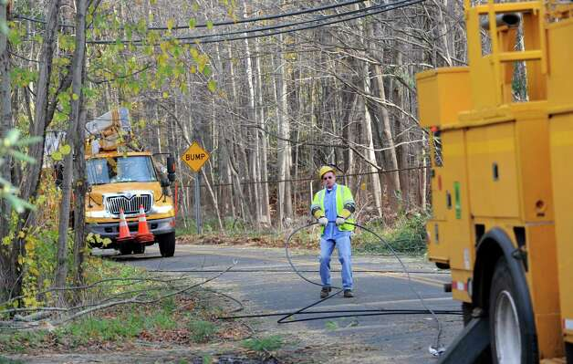 Crews from Connecticut Light & Power work on North Stamford Road at High Ridge Road, continuing the effort to restore service to Stamford, Conn. on Thursday, Nov. 1, 2012. Photo: Cathy Zuraw / Stamford Advocate