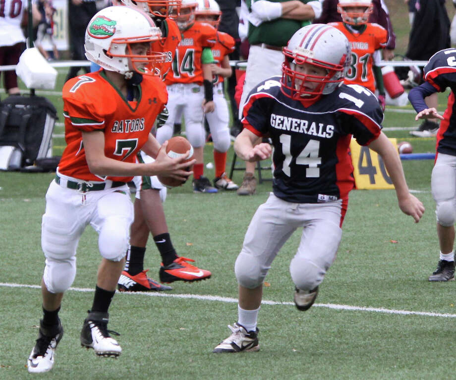 Harrison Barth (14) of the Junior Generals chases after Gators quarterback Garrett Murphy. Photo: Contributed Photo
