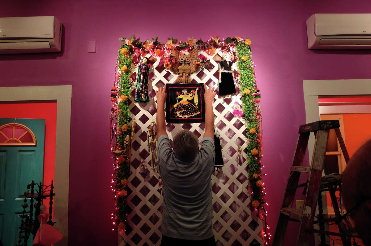 Bernard Sanchez positions a decorative panel on an altar for his family at the Rinconcito de Esperanza house on Tuesday, Oct. 30, 2012. About 20 altars were being put in the home which serves as a center for historical preservation for the Westside of San Antonio. A celebration for Dia de Los Muertos will be held at the home on Nov. 1 and will remain on display for 10 days thereafter. Read more