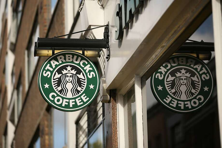 LONDON, ENGLAND - OCTOBER 16:  The signage on a branch of Starbucks Coffee on October 16, 2012 in London, England. It has been reveled that Starbucks, the world's second largest coffee chain, has paid no tax in the UK for the past three years despite sales exceeding 1 billion GBP. Since first trading in the UK in 1998 Starbucks has paid 8.6 million GBP in income tax with total sales of over 3 billion GBP in the same period.  (Photo by Oli Scarff/Getty Images) Photo: Oli Scarff, Getty Images