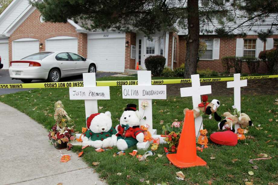 A makeshift memorial was put up outside a home in Naperville, Ill., on Thursday where two children were stabbed to death Tuesday. Two dogs were also stabbed. Photo: M. Spencer Green, STF / AP