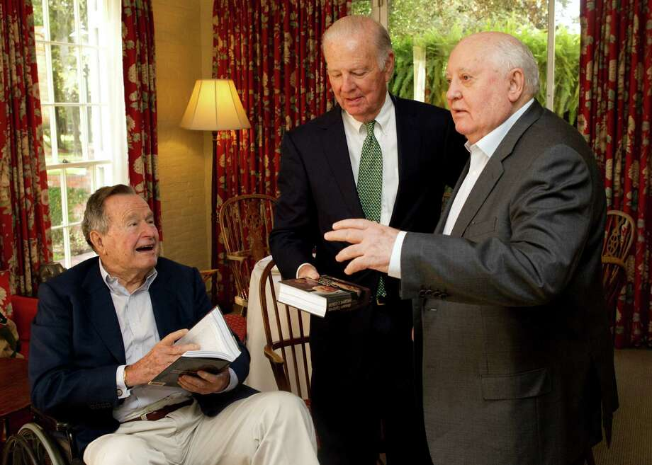 Mikhail Gorbachev, former leader of the Soviet Union, right, gives gifts of his book to former President George H.W. Bush Former, left, and former secretary of state James A. Baker III before having lunch together Thursday, Nov. 1, 2012, in Houston. Photo: Brett Coomer, Houston Chronicle / © 2012 Houston Chronicle