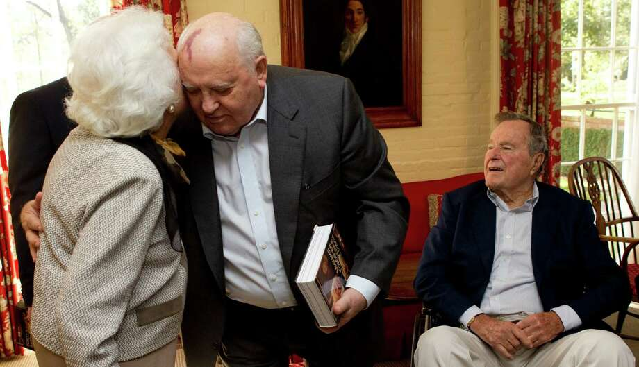Former first lady Barbara Bush, left, embraces Mikhail Gorbachev, former leader of the Soviet Union, during a lunch with Mrs. Bush and former President George H.W. Bush Thursday, Nov. 1, 2012, in Houston. Photo: Brett Coomer, Houston Chronicle / © 2012 Houston Chronicle