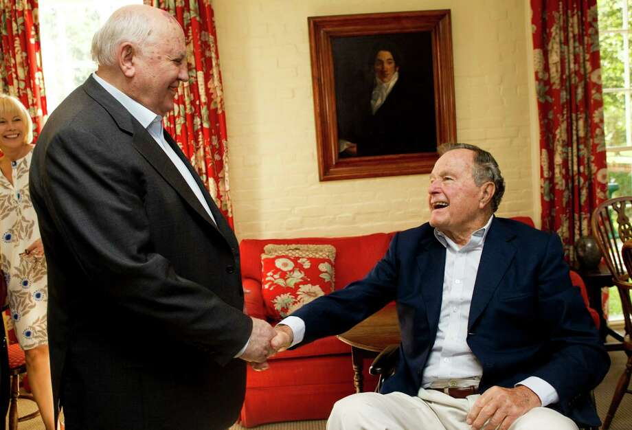 Mikhail Gorbachev, former leader of the Soviet Union, left, greets former President George H.W. Bush before having lunch together Thursday, Nov. 1, 2012, in Houston. Photo: Brett Coomer, Houston Chronicle / © 2012 Houston Chronicle