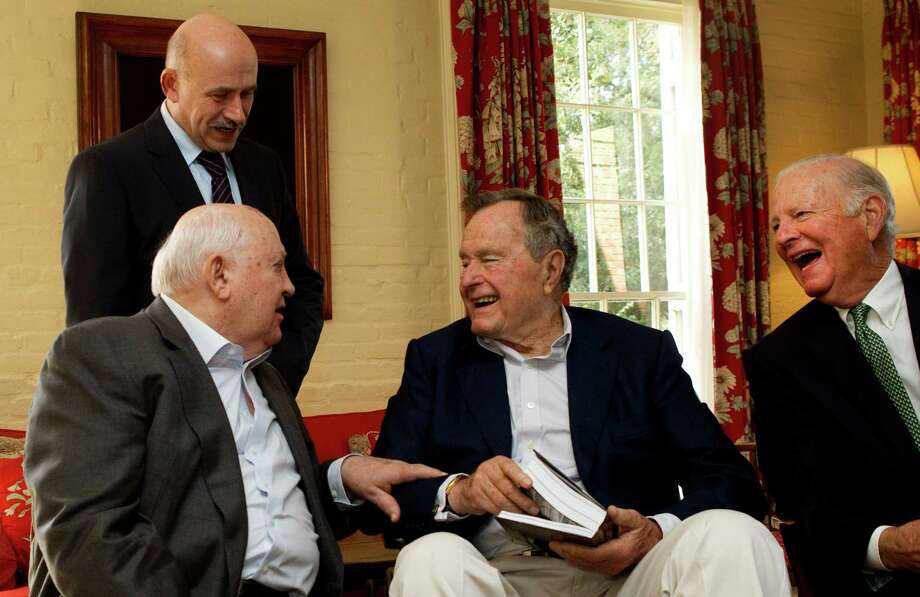 Mikhail Gorbachev, former leader of the Soviet Union, left, shares a laugh with former President George H.W. Bush and former secretary of state James A. Baker III before having lunch together Thursday, Nov. 1, 2012, in Houston. Pavel Palazhchenko, adviser to Gobachev, is shown in the background. Photo: Brett Coomer, Houston Chronicle / © 2012 Houston Chronicle