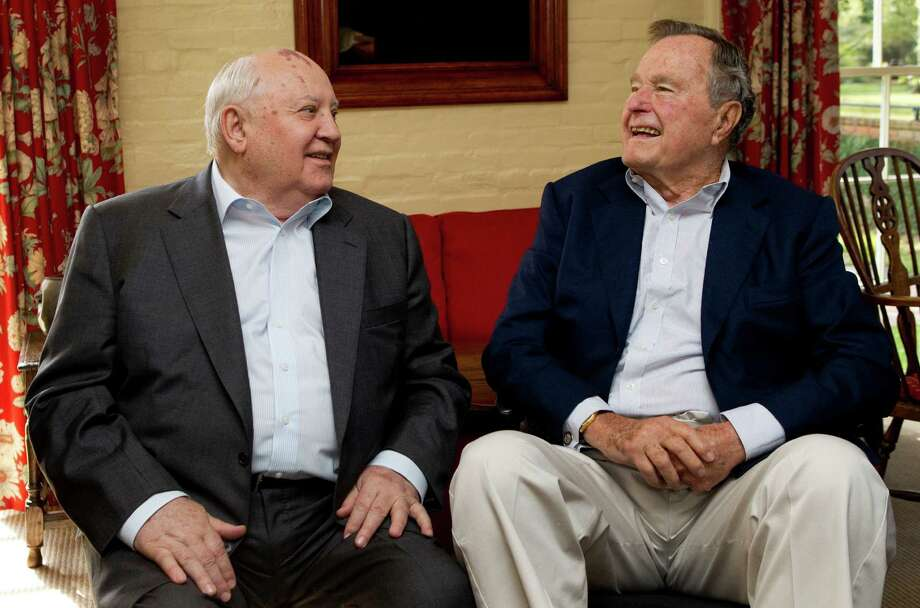 Mikhail Gorbachev, former leader of the Soviet Union, left, sits down to talk with former President George H.W. Bush before having lunch together Thursday, Nov. 1, 2012, in Houston. Photo: Brett Coomer, Houston Chronicle / © 2012 Houston Chronicle