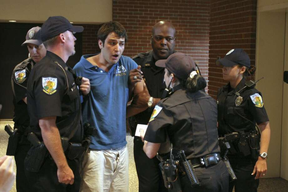 Andrew Meyer speaks with university police after being removed from a forum where Sen. John Kerry was speaking in Gainesville, Fla., on Monday Sept. 17, 2007. (AP Photo/Independent Florida Alligator, Andrew Stanfill) (AP)