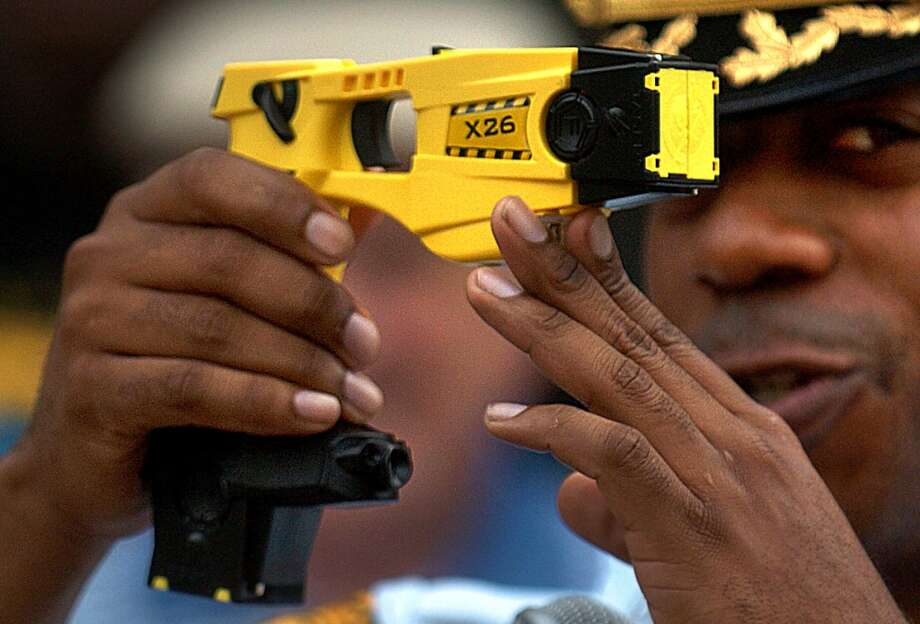 Former Bridgeport Police Chief Brian Norwood displays a taser gun during a demonstration held outside the City Hall Annex, in Bridgeport, Conn. on June 20, 2007. (Connecticut Post / File Photo)
