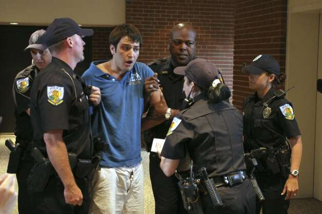 "University of Florida student Andrew Meyer speaks with university police after being removed from a forum where Sen. John Kerry was speaking in Gainesville, Fla., Monday Sept. 17, 2007.  He was subdued with a stun gun as he shouted ""Don't Tase me, bro!"" (AP Photo/Independent Florida Alligator, Andrew Stanfill) (AP)"