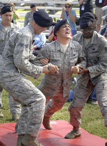 Airman 1st Class Victor Villasante reacts to being shot by a taser on Thursday Oct. 4, 2012 during a demonstration for Vietnam veterans who served as security police in the war. (AP Photo/Northwest Florida Daily News, Nick Tomecek) (Associated Press)