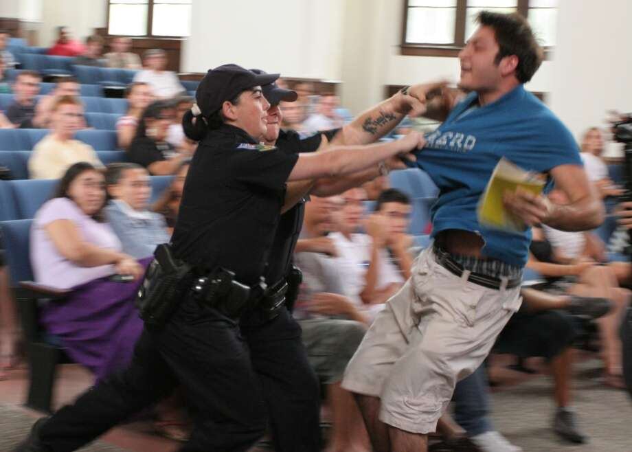 "University of Florida student Andrew Meyer struggles with University Police as officers try to remove him from a question and answer session with Sen. John Kerry, D-Mass., in Gainesville, Fla., on Monday Sept. 17, 2007. He was subdued with a stun gun as he shouted ""Don't Tase me, bro!"" (AP Photo/Independent Florida Alligator, Andrew Stanfill) (AP)"