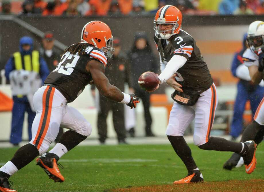 Cleveland Browns quarterback Brandon Weeden (3) hands the ball to running back Trent Richardson (33) against the San Diego Chargers during an NFL football game in Cleveland, Sunday, Oct. 28, 2012. (AP Photo/Phil Long) Photo: Phil Long, Associated Press / FR53611 AP