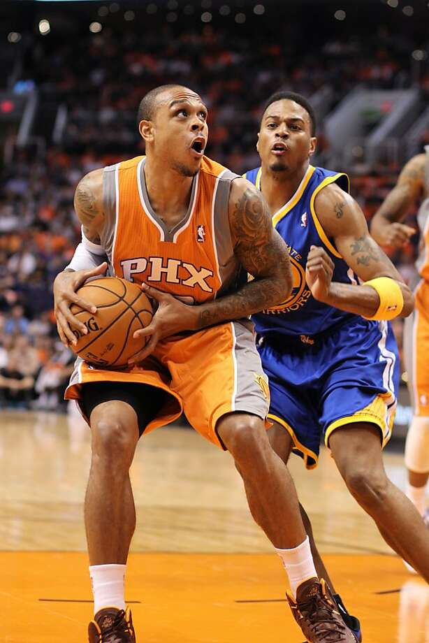 Warriors forward Brandon Rush (right), covering the Suns' Shannon Brown in Wednesday's opener, displayed aggressive defense along with his instant offense (14 points) off the bench. Photo: Paul Connors, Associated Press