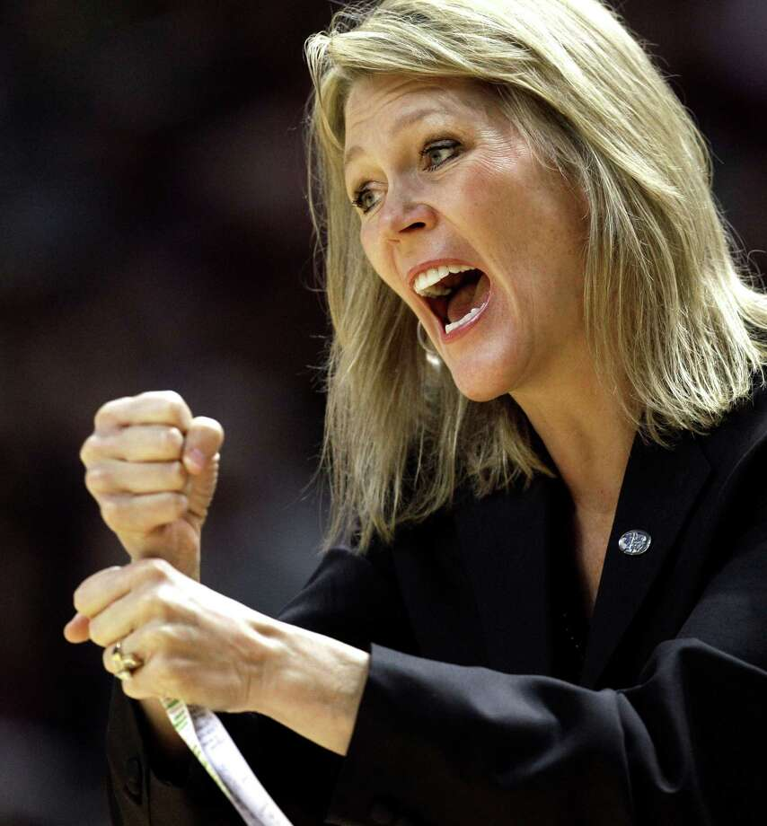Albany coach Katie Abrahamson-Henderson calls a play during the first half of an NCAA tournament first-round college basketball game against the Texas A&M, Saturday, March 17, 2012, in College Station, Texas. (AP Photo/David J. Phillip) Photo: David J. Phillip / AP