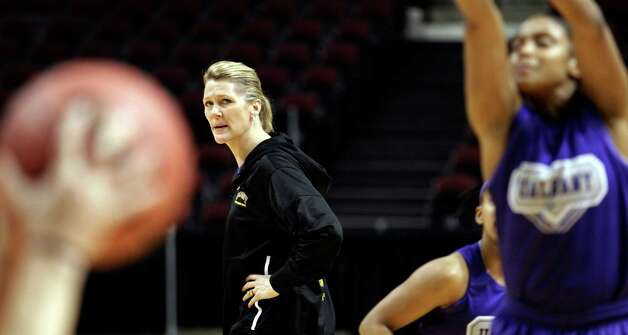 Albany women's basketball coach Katie Abrahamson-Henderson watches her team during basketball practice in College Station, Texas, Friday, March 16, 2012. Albany is to play Texas A&M in an NCAA tournament first-round women's college basketball game on Saturday. (AP Photo/David J. Phillip) Photo: David J. Phillip / AP