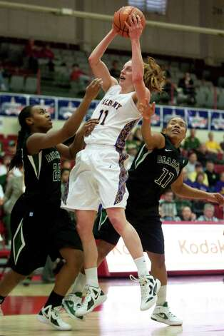 Julie Forster of UAlbany (center) collect a rebound between Jasbriell Swain (left) and Andrea Holmes (right) of Binghamton, during an America East Semifinal game where the Great Danes defeated Binghamton 58-50 at Chase Family Arena in Hartford, CT on March 4, 2012 (Shane Bufano/Special to the Times Union). Photo: Shane Bufano