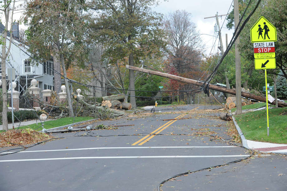 Telephone poles and a transformer blocking in at least one homeowner on Milbank Avenue an important connector in central Greenwich, Conn. on Thursday, Nov. 1. 2012. Photo: Helen Neafsey / Greenwich Time