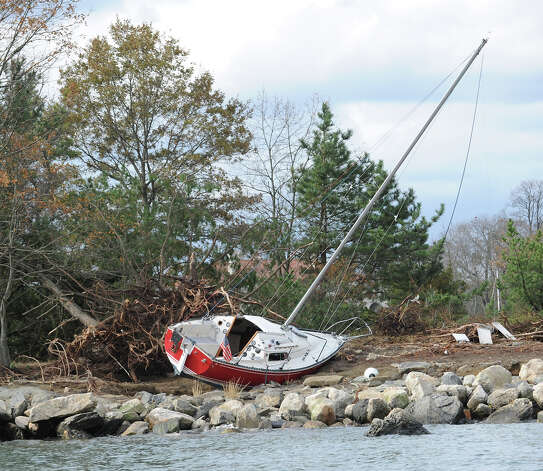 A shipwrecked sailboat on a small Island as seen during a tour of the Greenwich coastline given by Greenwich Harbor Master Ian MacMillan of the damaged caused by Hurricane Sandy, November 1, 2012. Photo: Bob Luckey / Greenwich Time