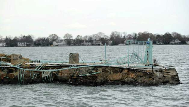 The storm-damaged dock at the Greenwich mansion of Frank and Kathie Lee Gifford as seen during a tour of the Greenwich coastline given by Greenwich Harbor Master Ian MacMillan of the destruction caused by Hurricane Sandy, November 1, 2012. Photo: Bob Luckey / Greenwich Time