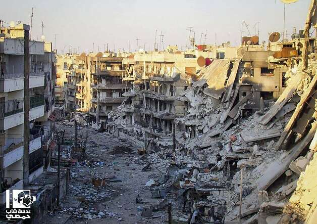 A neighborhood in Qossour, Syria, lies in ruins after a bombardment by government forces Wednesday. Photo: Anonymous, Associated Press