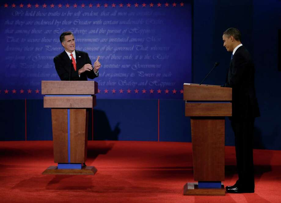 As Mitt Romney and President Barack Obama head down to the wire, columnists point out their flaws. Photo: Eric Gay, Associated Press / AP