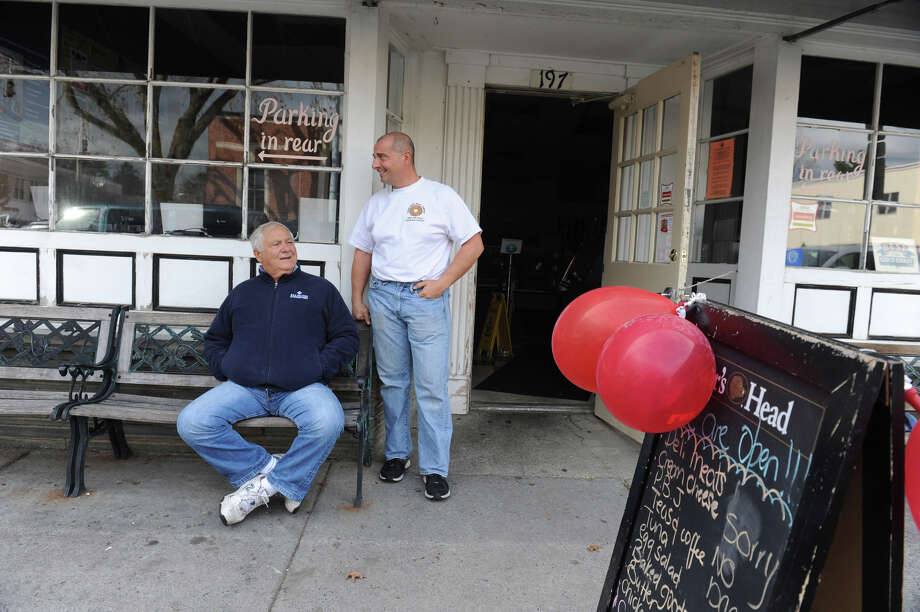 Bob Guerrieri, left, and his son Rob, the owner of Upper Crust Bagel Company & Deli, hoped that people will come and eat although the deli was dark. It was quiet afternoon after the storm in Old Greenwich, Conn. on Thursday, Nov. 1. 2012. Photo: Helen Neafsey / Greenwich Time