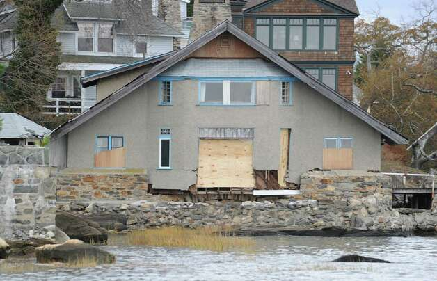 A storm-damaged Greenwich home seen during a tour of the Greenwich coastline given by Greenwich Harbor Master Ian MacMillan of the destruction caused by Hurricane Sandy, Thursday, November 1, 2012. Photo: Bob Luckey / Greenwich Time