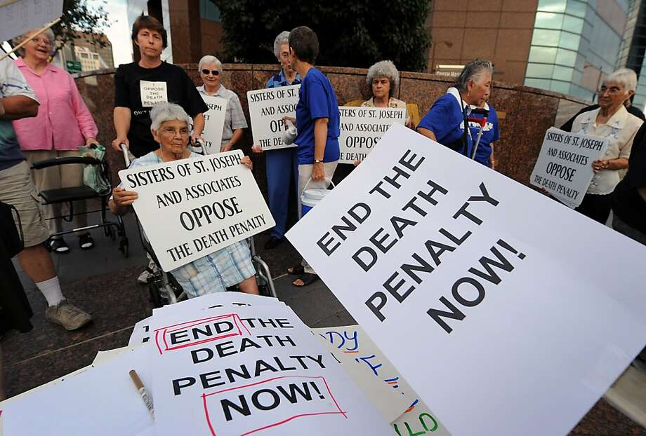Anti-death penalty campaigners stage a demonstration and march outside the Federal Bulding in Los Angeles in this September 28, 2010 file photo.  California voters will also be asked if it is time to repeal the state's death penalty. There are currently 724 people on the state's death row but California has only executed 13 people since the death penalty was reinstated in 1976. Some 17 states have already abolished the death penalty. Photo: Mark Ralston, AFP/Getty Images