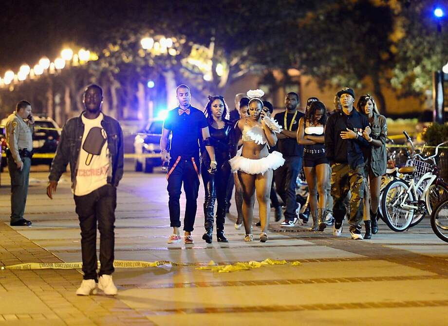 People who attended a Halloween party are allowed to leave after a lockdown that followed the shooting. Photo: Kevork Djansezian, Getty Images