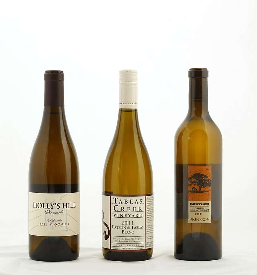 Left-right: 2011 Holly's Hill Viognier, 2011 Tablas Creek Patelin de Tablas Blanc, 2011 Kinero Rustler James Berry Vineyard Roussanne  as seen in San Francisco, California on Wednesday, October 31, 2012. Food styled by Katie Fleming. Photo: Craig Lee, Special To The Chronicle